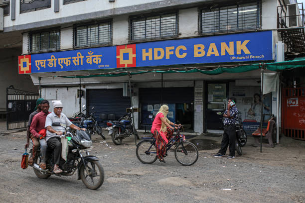 HDFC Bank shares surge to record high post Q2 results. Should you buy, sell or hold