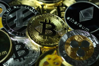 Cryptocurrency prices today: Bitcoin below USD 57,000, ether, dogecoin also slip. Latest rates